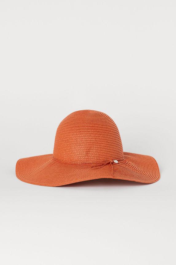 Burnt-orange coloured straw hat
