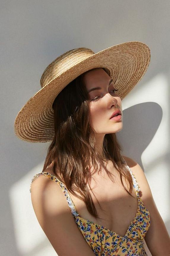 Model wears a straw boater-style sun hat