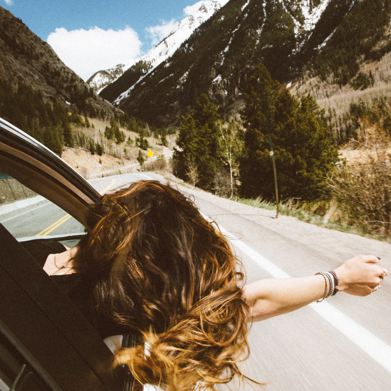Woman on a road trip feeling free