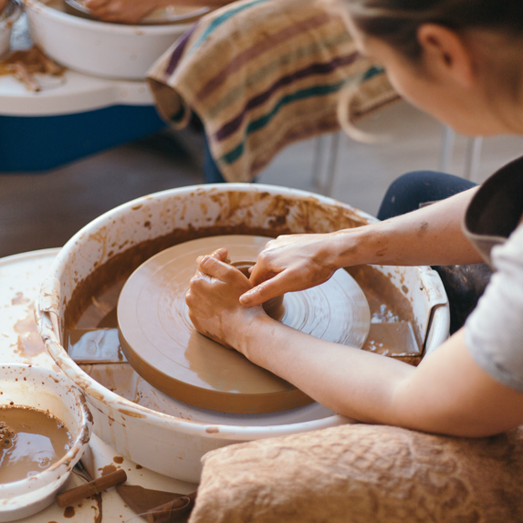Someone doing pottery