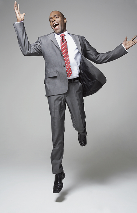 Man in suit jumping