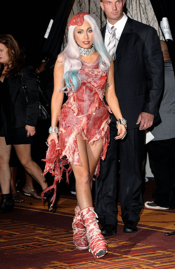 Lady Gaga wears an ensemble made entirely of raw meat to the 2010 MTV Video Music Awards