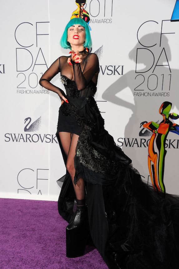 Lady Gaga walks the red carpet at the CFDA Awards in 2011