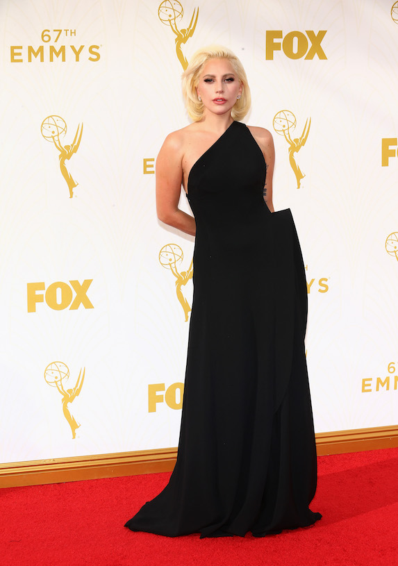 Lady Gaga wears a black one-shoulder gown to the 2015 Emmy Awards