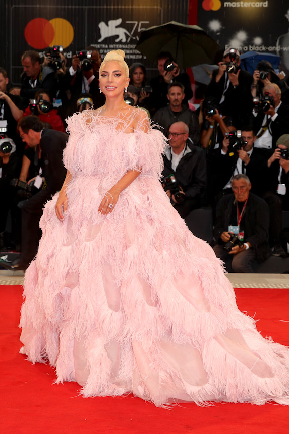 Lady Gaga wears a pink feathered dress at the 75th Venice Film Festival in 2018