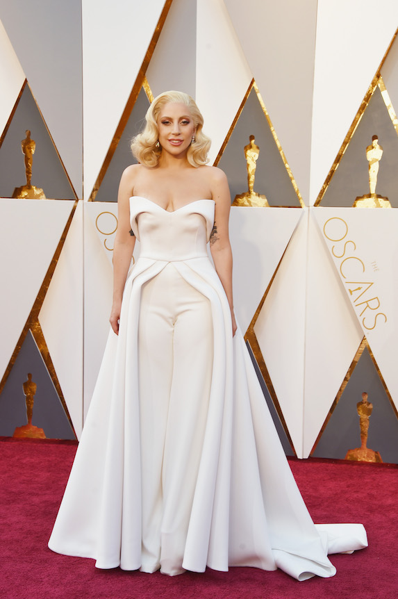 Lady Gaga wears a white jumpsuit on the red carpet for the 88th annual Academy Awards in 2016