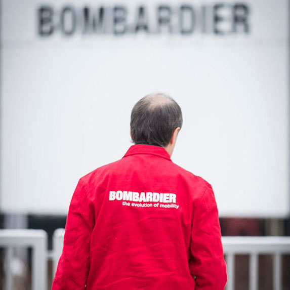 The back of a man wearing a Bombardier jacket