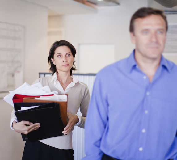 Woman looking irritated with her male coworker