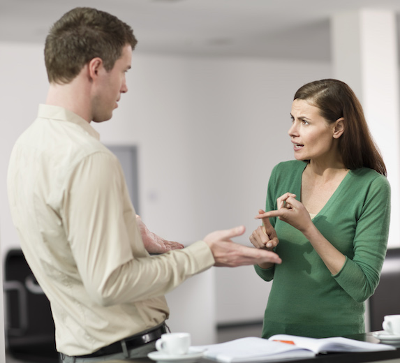 Man and woman having a tense discussion at work