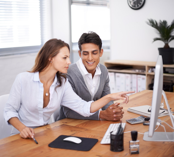 Male coworker looking at his female coworker inappropriately at the office