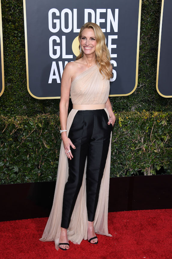Julia Roberts poses on the Golden Globe red carpet in a trouser and dress combo by Stella McCartney