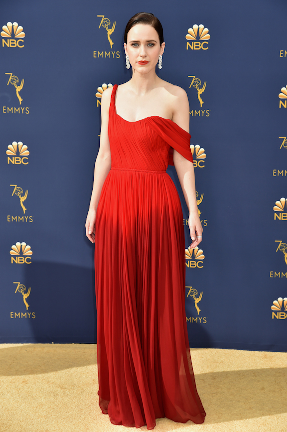 Actress Rachel Brosnahan wears a red gown at the Emmy Awards