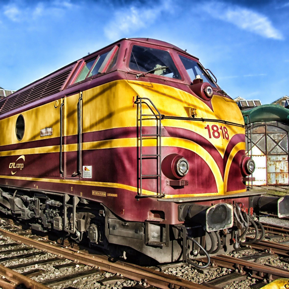 a yellow and red locomotive