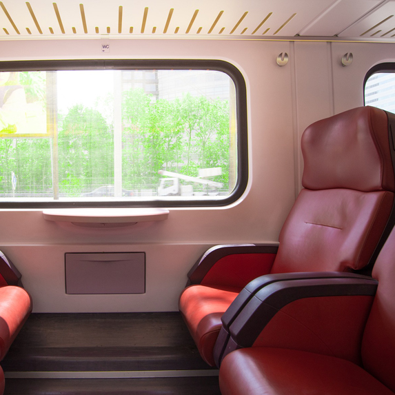 inside a train with red seats
