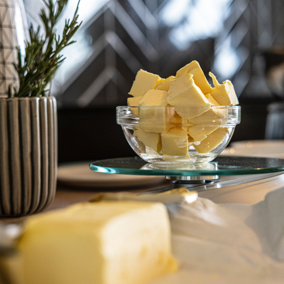 a bowl of butter on a kitchen counter