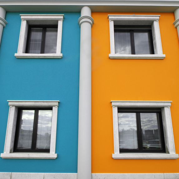 a yellow and blue apartment building