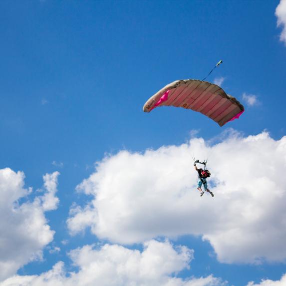 someone parachuting through the air