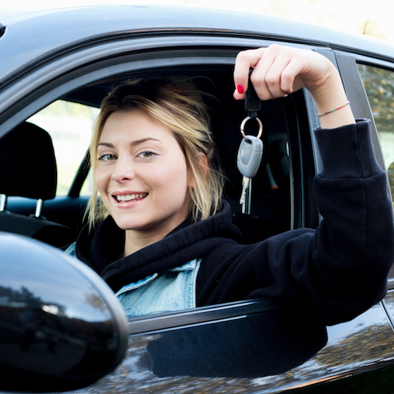 Young woman with car keys