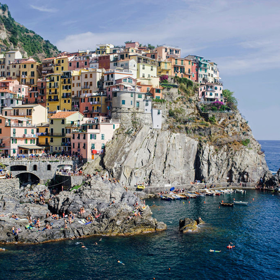 Rainbow-coloured villas perch along the cliffs of Manarola alongside the Meditteranean sea