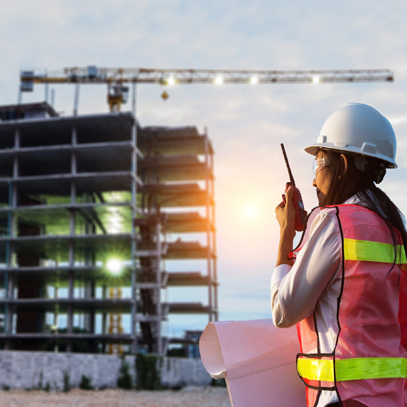 Construction manager using a walkie-talkie