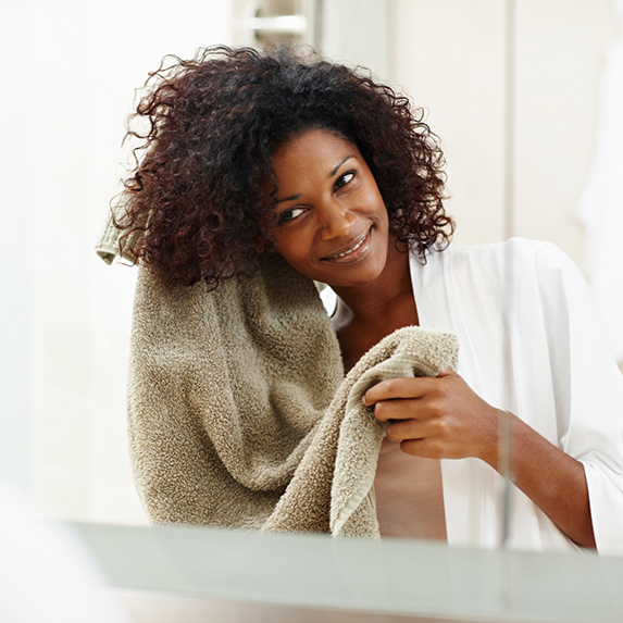 Woman towels her hair