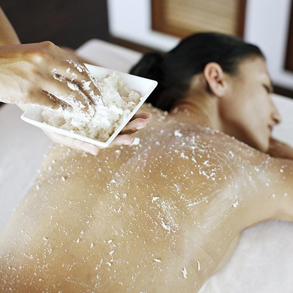 woman receiving a scrub treatment