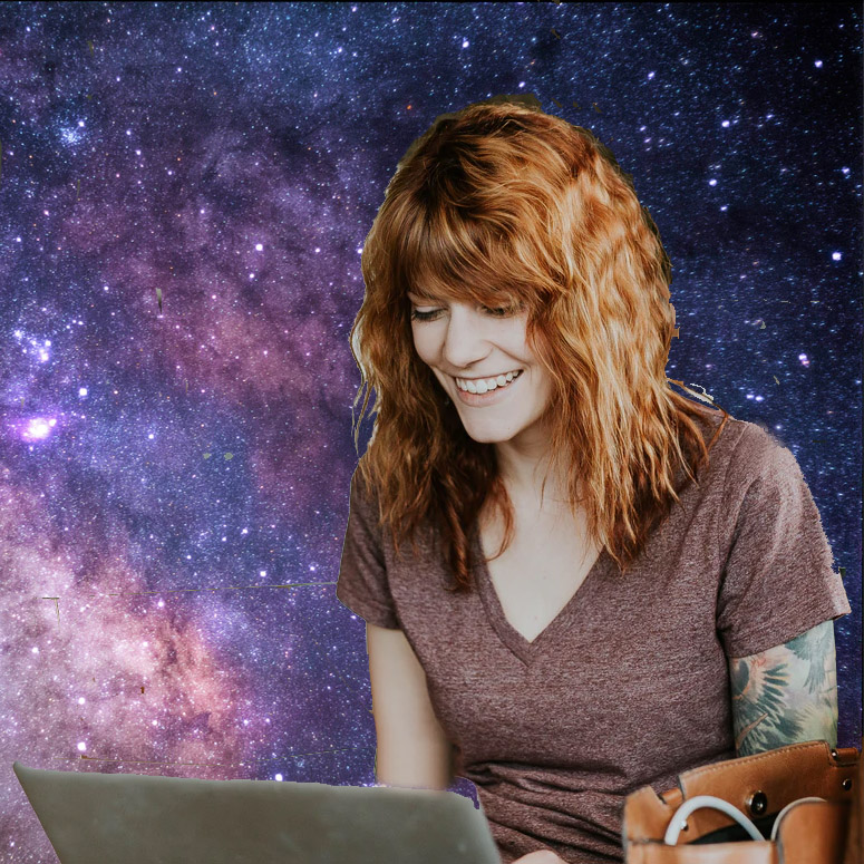 Woman on a laptop as she turns to the cosmos for insights