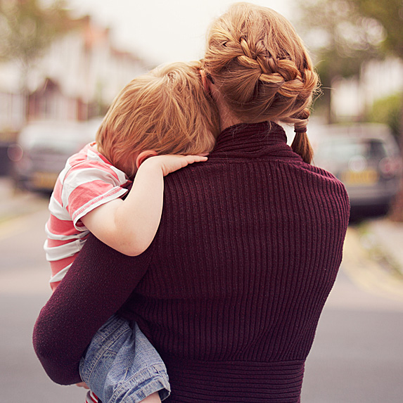 Back of woman holding child