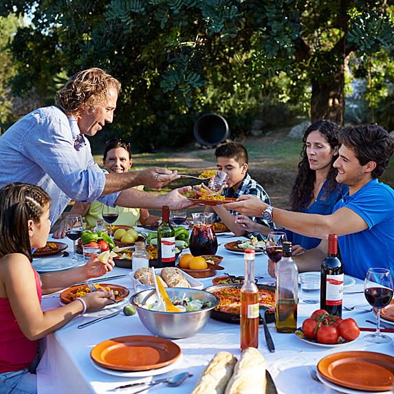 Multigenerational family having dinner outside