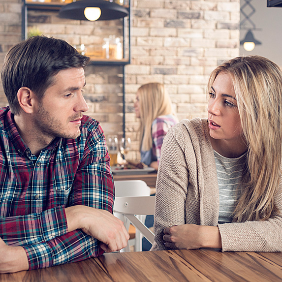 Woman looking at man in surprise