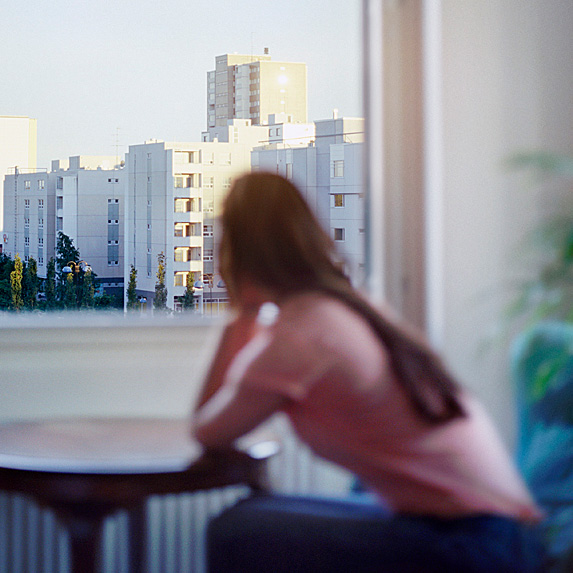 Woman looking out window at