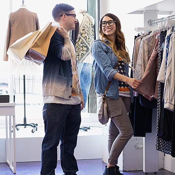 Man and woman shopping in clothing store