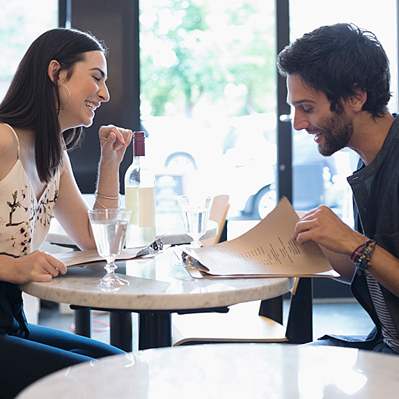 Woman and man looking at papers in coffee shop