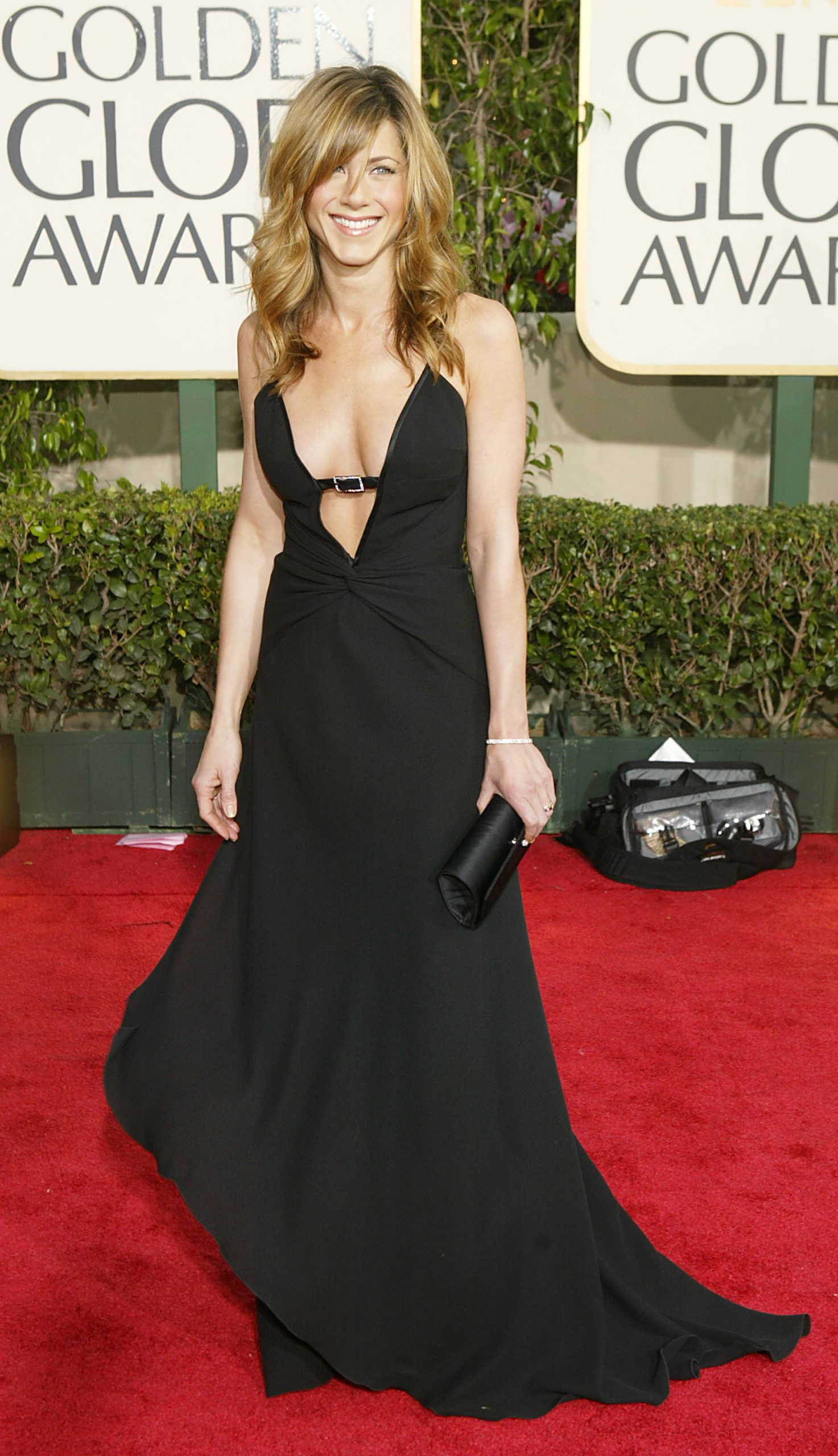 Jennifer Aniston wears a gown with a low neckline to the Golden Globe Awards in 2004