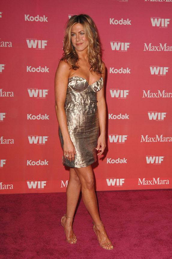 Jennifer Aniston wears a metallic mini dress at a Women In Film event