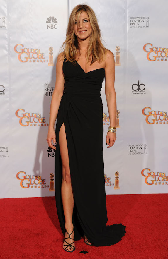 Jennifer Aniston wears a one-shoulder black gown with high slit to the 2010 Golden Globe Awards