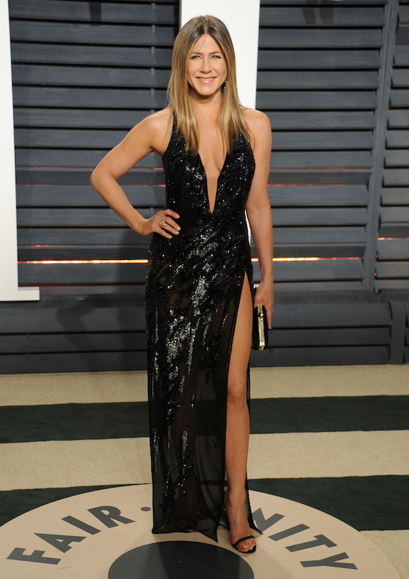 Jennifer Aniston wears a beaded gown with high slit and low neckline to the 2017 Vanity Fair Oscar Party