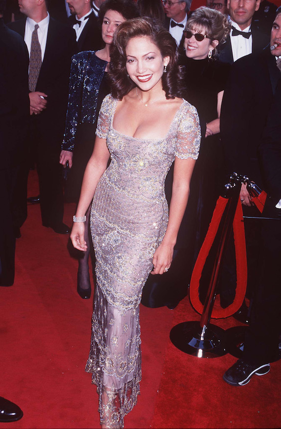 Jennifer Lopez wears an embellished gown with short sleeves to the 1997 Academy Awards