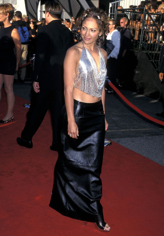 Jennifer Lopez wears a maxi skirt, sequin halter top and platform sandals to the MTV Awards in 1998