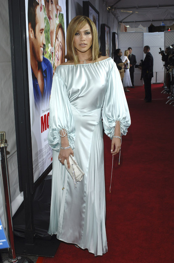 Jennifer Lopez wears a pale blue satin gown with long sleeves on the red carpet at the premiere of her film, Monster In Law