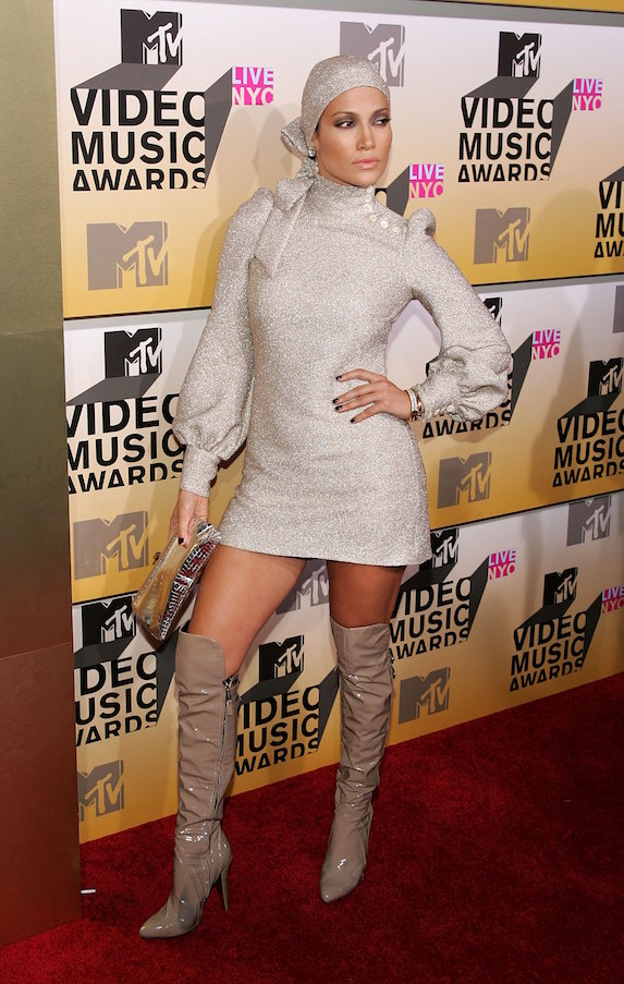 Jennifer Lopez wears a sparkly mini dress, head scarf and patent boots to the 2006 MTV Awards