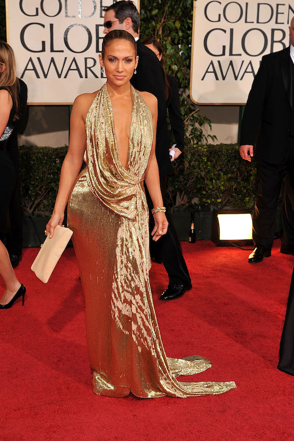 Jennifer Lopez wears a gold Marchesa gown on the red carpet to the 2009 Golden Globe Awards