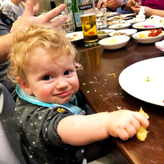 Adorable baby eating abroad