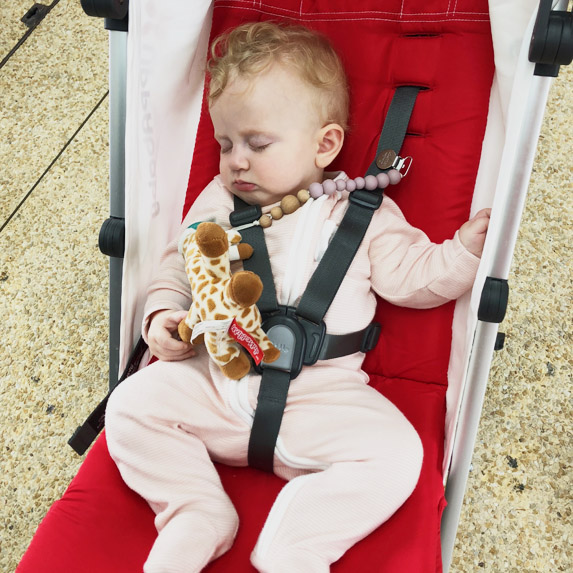 Baby takes a lil nap in a stroller