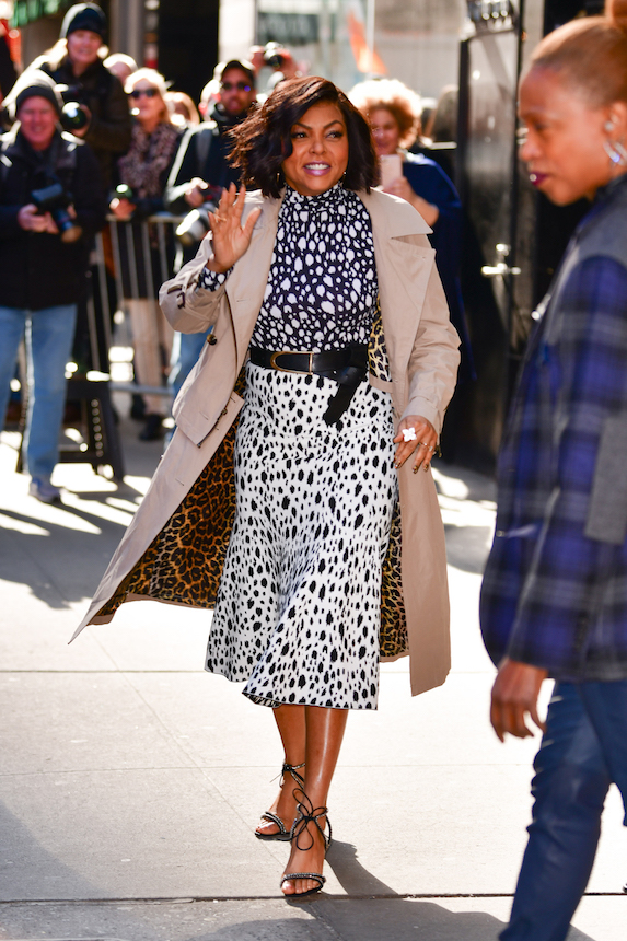 Taraji P. Henson wears a trenchcoat, print dress and black belt tied at the waist