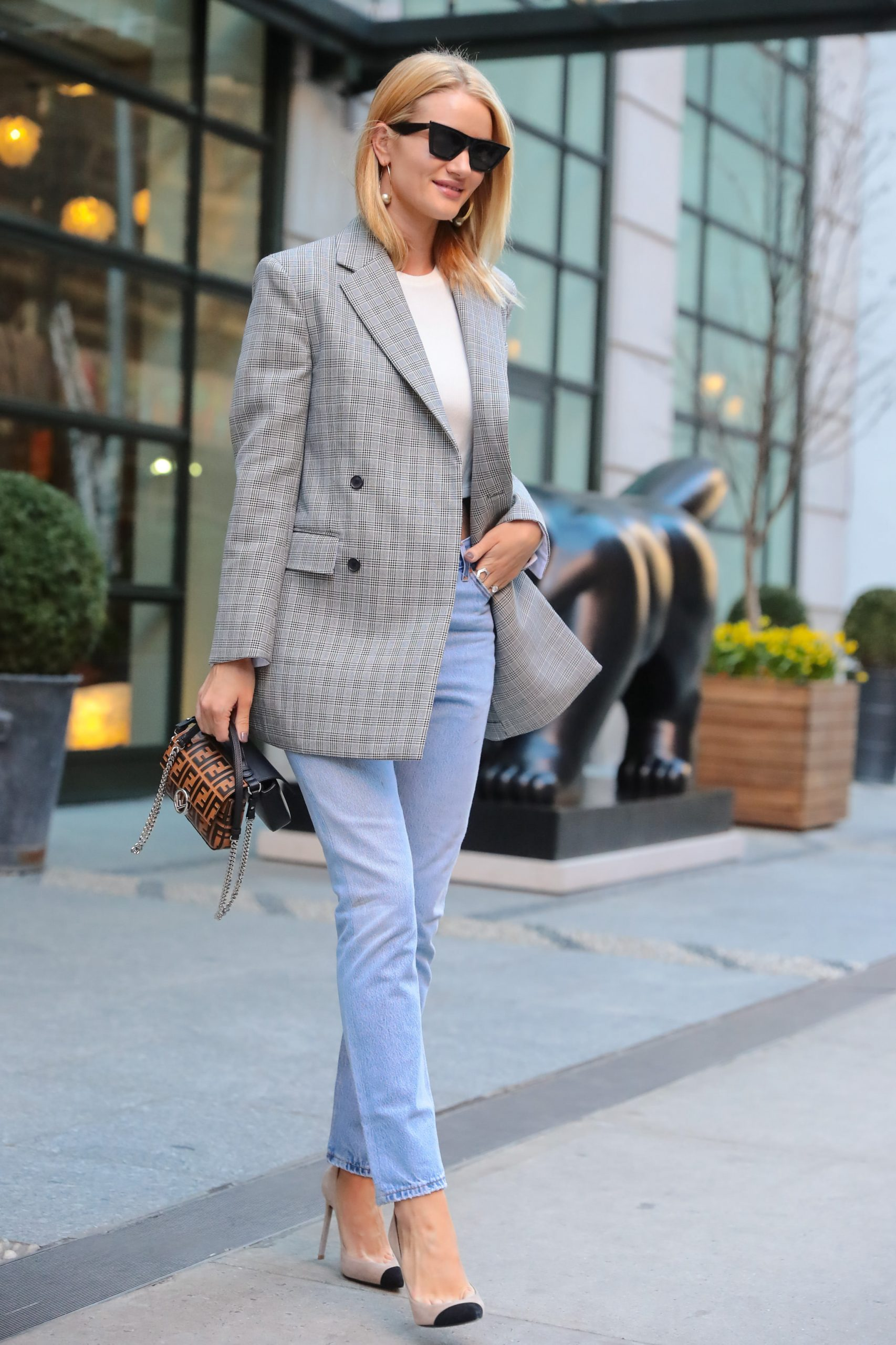 Rosie Huntington-Whiteley wears a check blazer over jeans