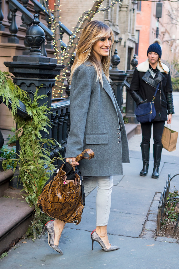 Sarah Jessica Parker wears a gray overcoat and accessorizes with a snake-print purse