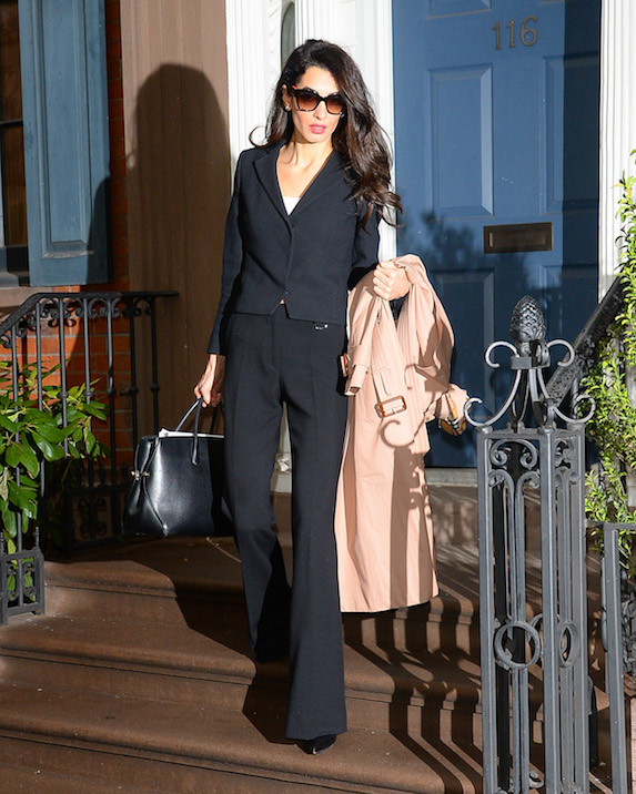 Amal Clooney wears a black suit jacket and flared suit pants