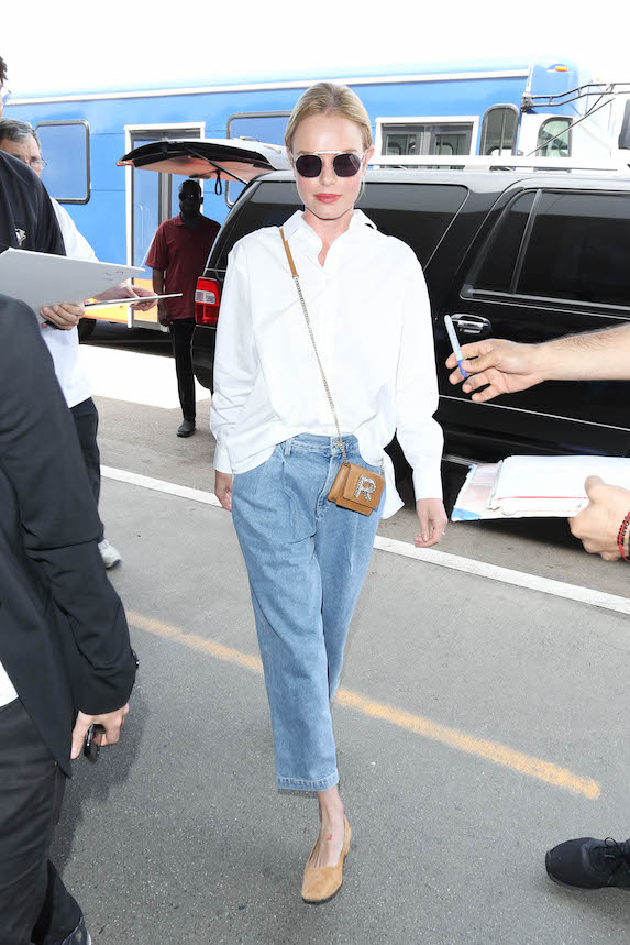 Kate Bosworth wears a white button-down shirt and jeans
