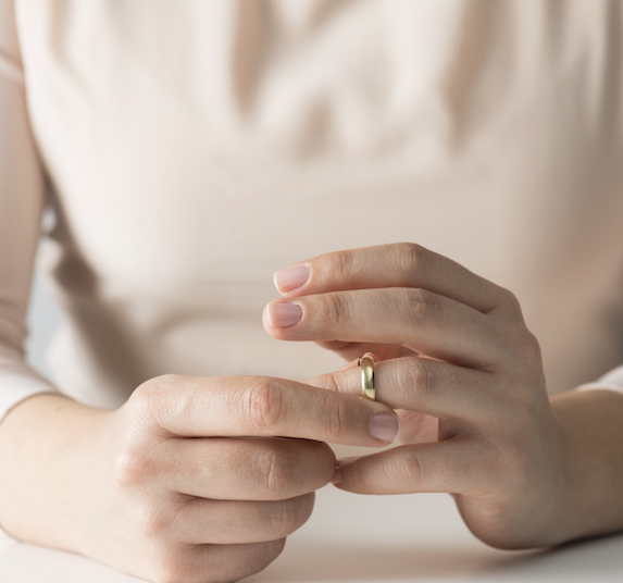 Closeup of a woman's hands and wedding ring